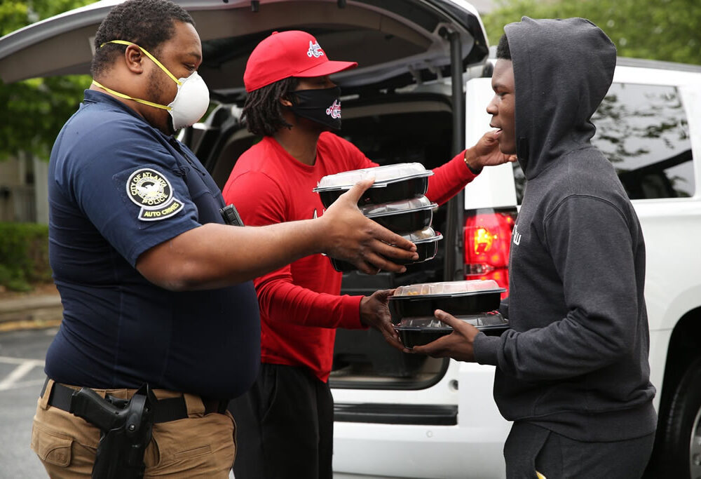 APD Officer and L.E.A.D. Programs Manager deliver hot meal to L.E.A.D. Ambassador